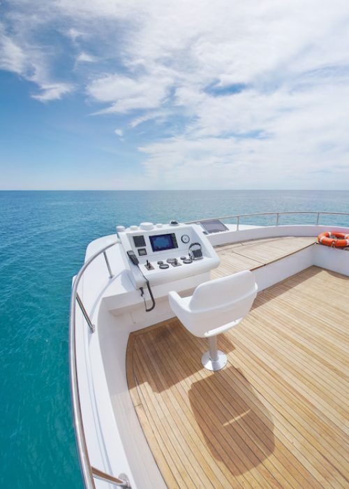 View from yacht flybridge open deck on the calm sea water at day. Modern and luxury equipped with navigation dashboard devices. Lifestyle freedom concept. Recreation on sea travel.